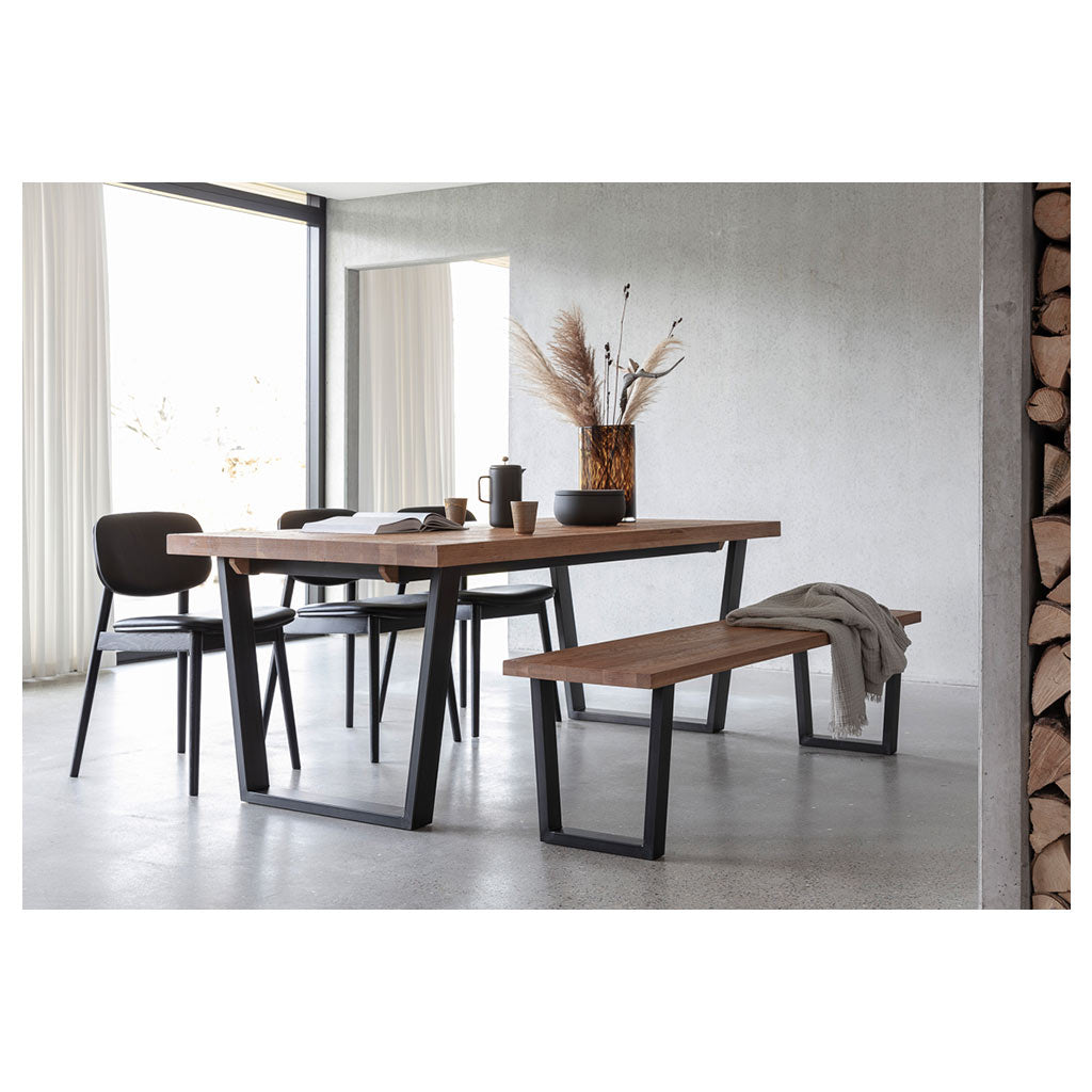 Calia dining table and bench seat in industrial setting