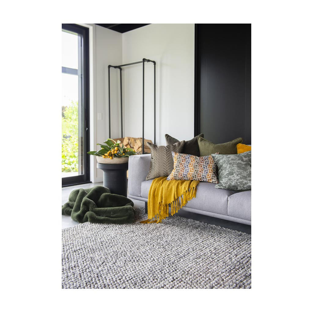 Clutha floor rug in setting