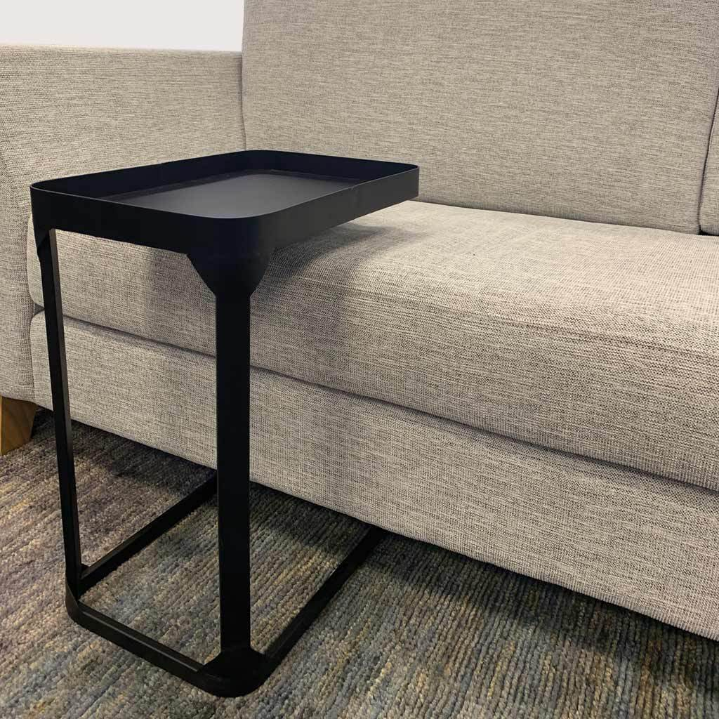 Metal side table used with sofa