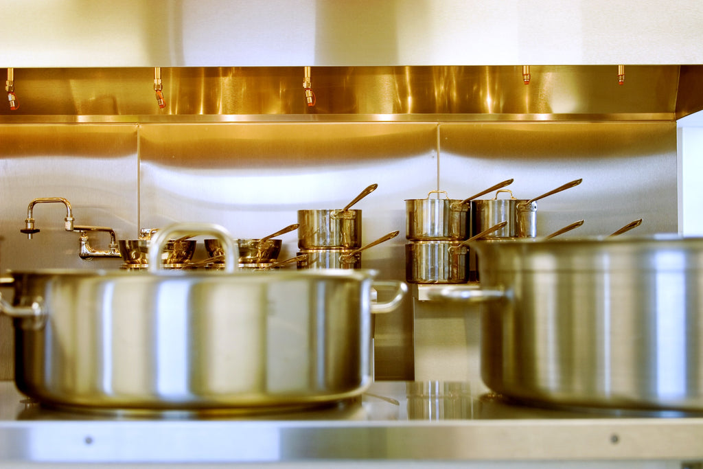 stainless steel pans in a kitchen