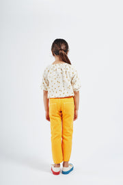 bobo choses ss20 A Dance Romance Daisy peasant Blouse for kids model picture girl wearing white with yellow floral print blouse and yellow trousers 12001058 BACK