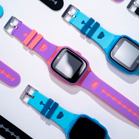 Different colors of COSMO's JrTrack watch are arranged.