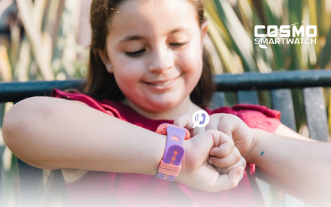 Girl wearing a smart watch made just for kids, the COSMO Smartwatch