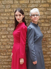 A younger and older women dressed in professional womenswear