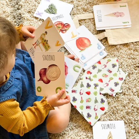"""Child looking at """"Market Haul"""" ABC Flashcards"""