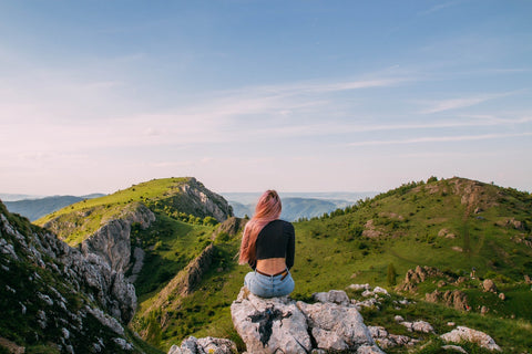 woman at top of mountain