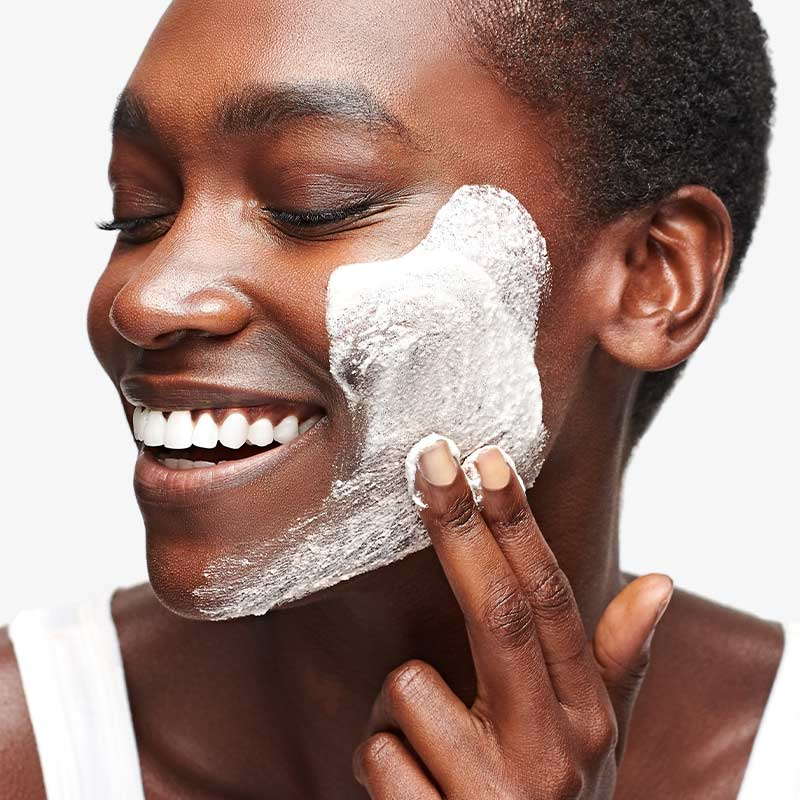 woman with product on face