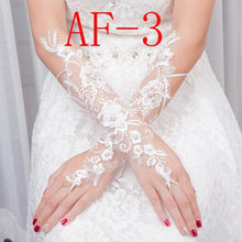 Load image into Gallery viewer, 1 Pair Fingerless Short Wedding Gloves Wrist Length Lace Appliques Sequins Bridal Gloves Hollow White Lace Glove Accessories