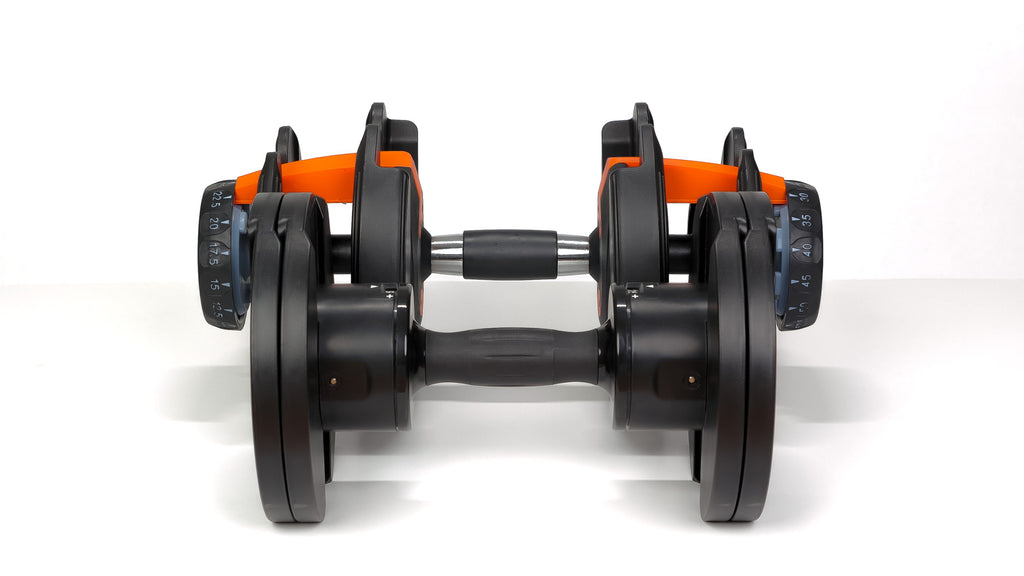 Core Home Fitness adjustable dumbbell lying next to competitor's dumbbell