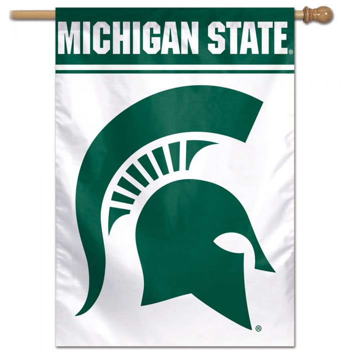 "Photo of  an MSU green-and-white flag, featuring multiple MSU logos, is made of durable, machine washable polyester. The 27"" x 37"" flag with 2.5"" pole sleeve is designed to hang vertically from an outdoor pole or inside as a wall decoration."