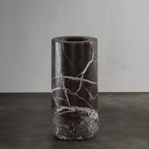 Cylindrical shaped vase in rosso levanto marble