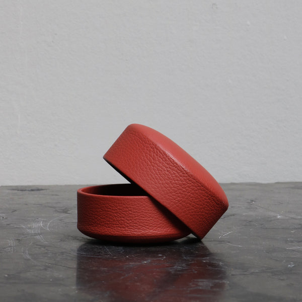 Pastille in red covered leather