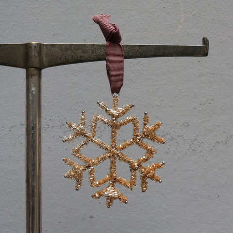 Hanging beaded snowflake in rusty colors