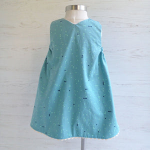 reversible jumper in dandelion puff - little girl Pearl