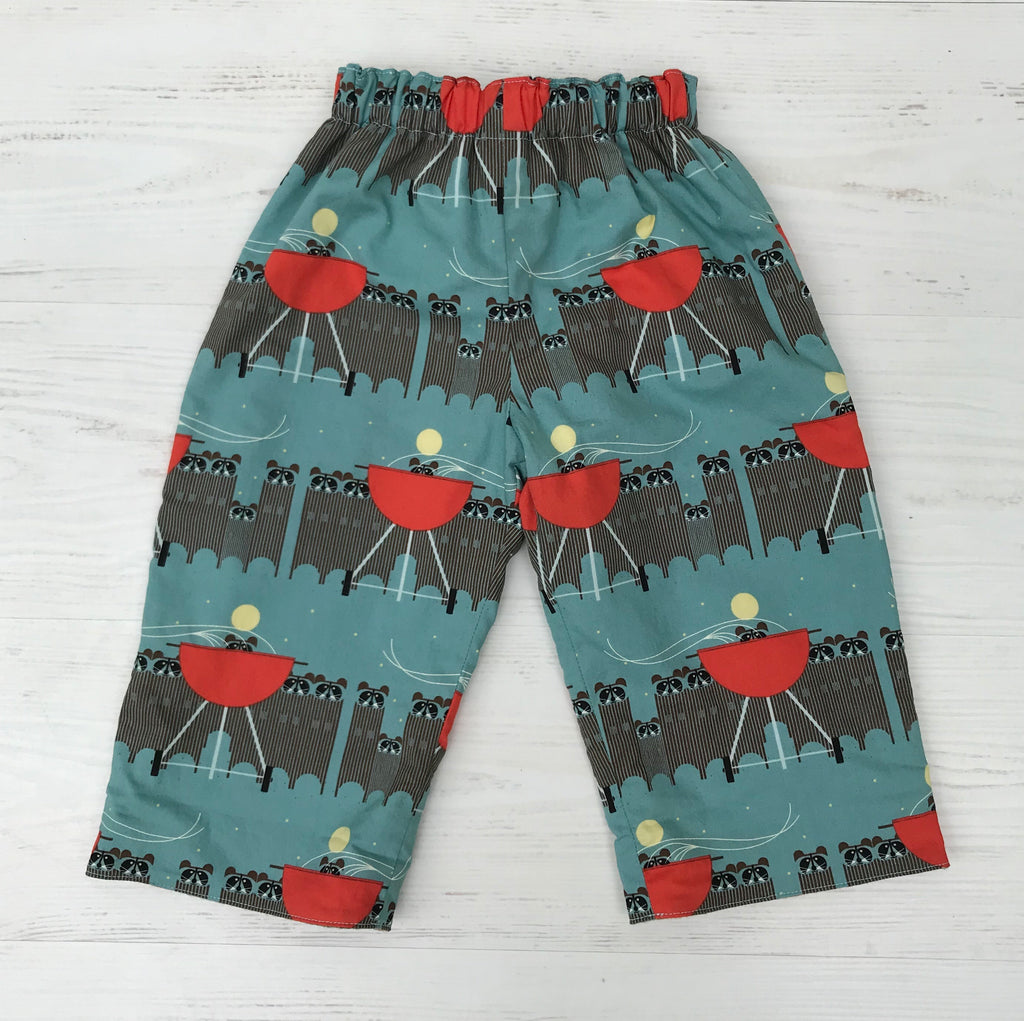 flannel reversible pants in Charley Harper raccoon attack - little girl Pearl