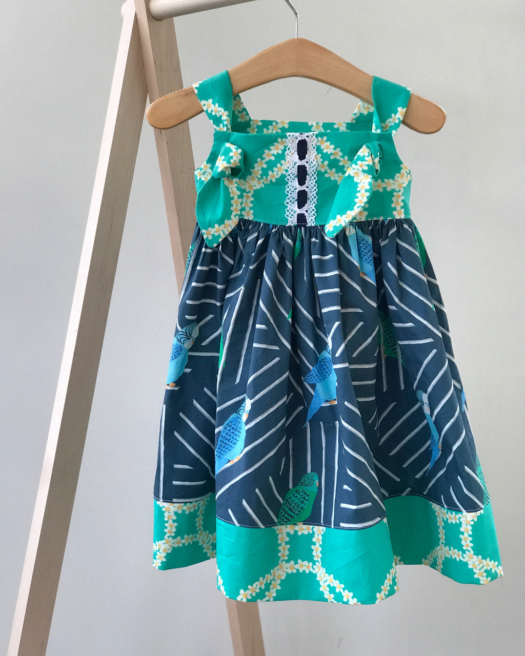 knot dress in navy regatta parakeet - little girl Pearl