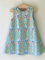 Load image into Gallery viewer, ghost wing asymmetric reversible jumper dress in aqua, LIMITED EDITION - little girl Pearl