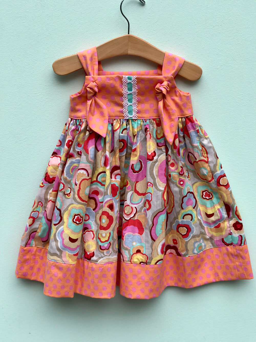 knot dress in peach and pink kite tails - little girl Pearl