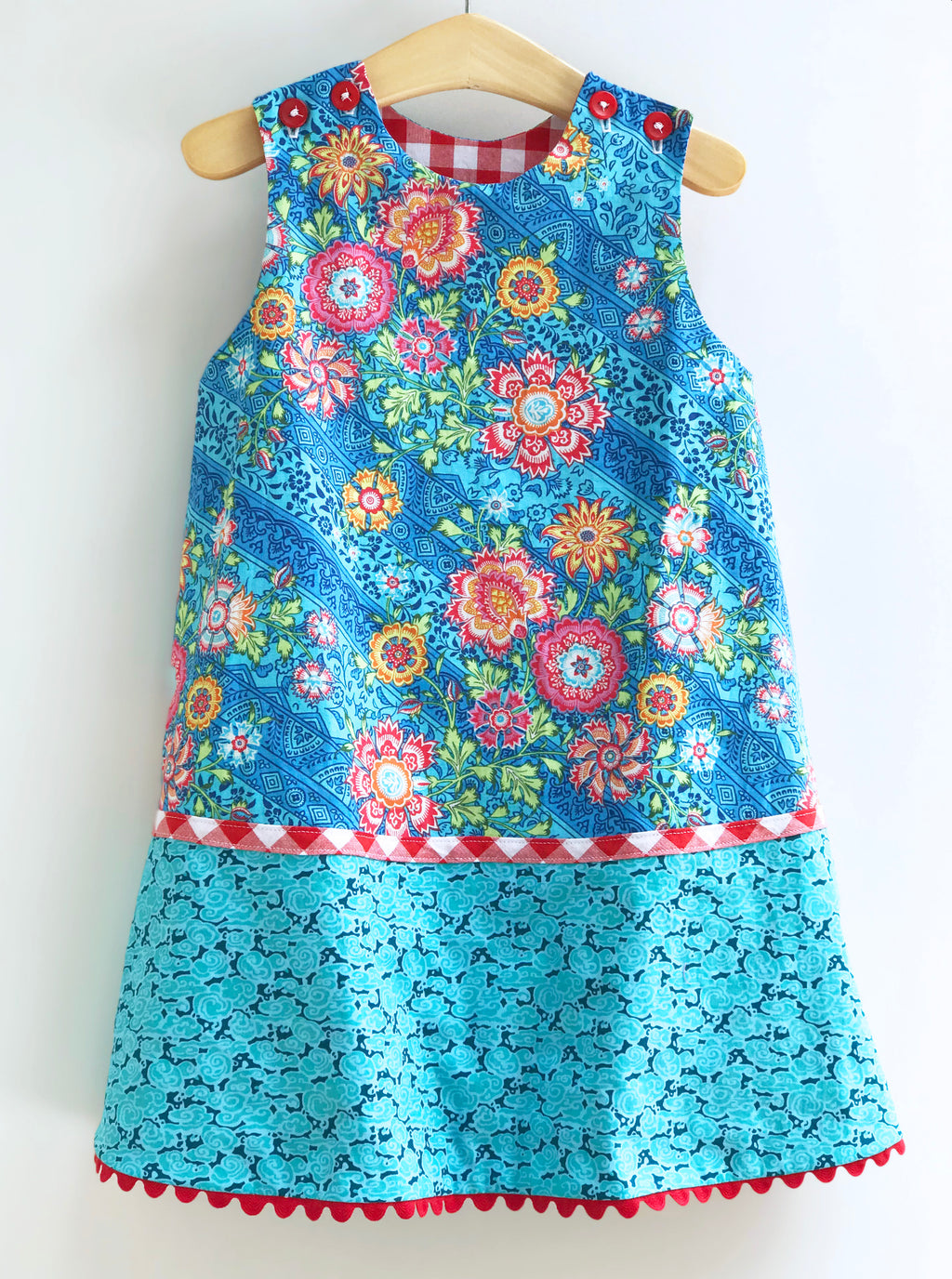 reversible pattern block jumper in aqua and red gingham - little girl Pearl