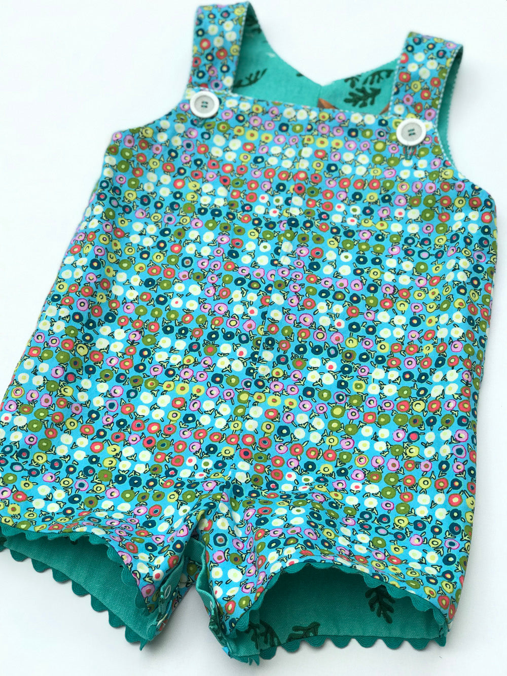 reversible shortalls in Charley Harper vireo and buttercups - little girl Pearl