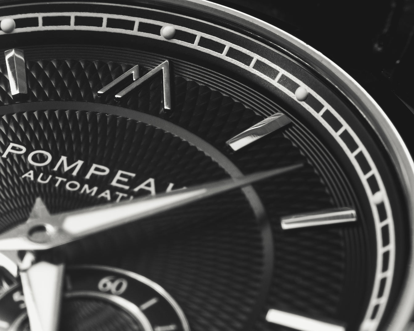 Pompeak automatic watch macro dial image.