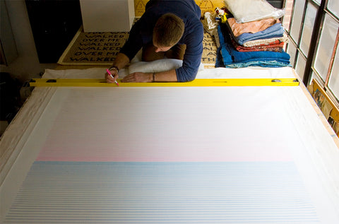 "The artist finishing up a large 68 x 58"" Horizon Line drawing"