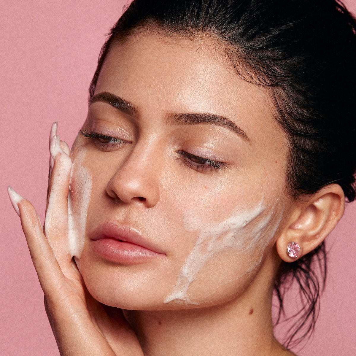Kylie using Kylie Skin Foaming Face Wash by Kylie Jenner