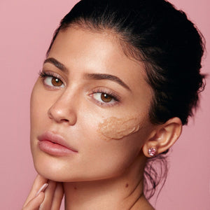 Kylie using Kylie Skin Walnut Face Scrub by Kylie Jenner