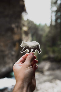 Hand holding Bear Landscape Sticker with mountains and trees