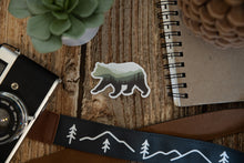 Load image into Gallery viewer, Bear Landscape Sticker on wood background with notebook camera and succulent