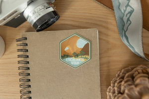Escalante utah sticker on notebook and wood background
