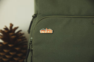 Wildtree utah enamel pin attached to backpack