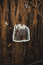 Load image into Gallery viewer, Find me in the woods cabin sticker sitting on log