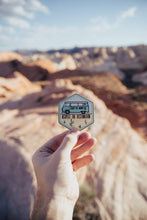 Load image into Gallery viewer, hand holding wildtree VW bus destination desert sticker in Valley of fire state park