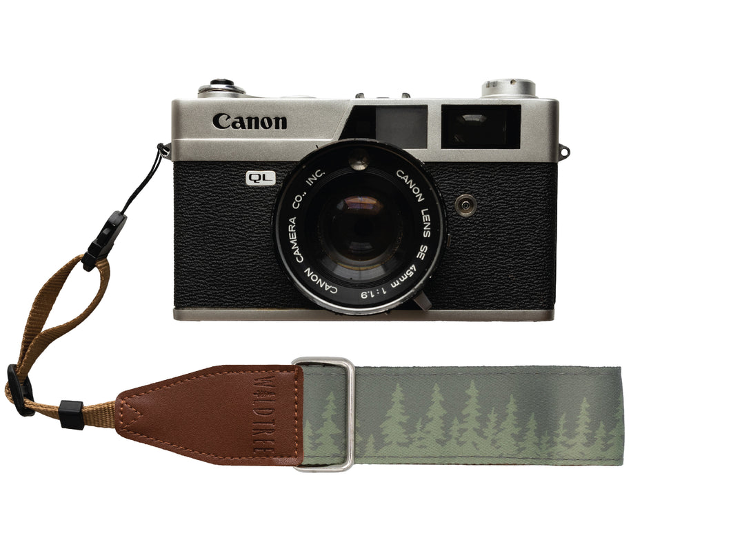 Wildtree Pine tree wrist strap attached to Canon film camera