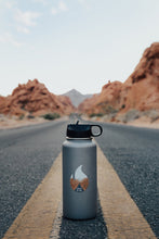 Load image into Gallery viewer, Wildtree Valley of Fire State Park Sticker on Hydro Flask sitting in middle of road