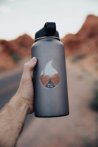 Wildtree Valley of Fire State Park Sticker on Hydro Flask being held out