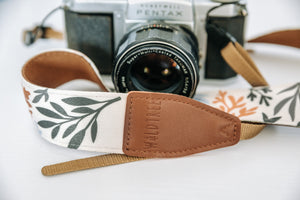 Wildtree leather stamped camera strap ends with floral flower camera strap attached to Pentax film camera