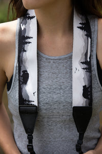 Women wearing Wildtree Wildlife Camera Strap featuring Bear, Moose and Trees with mountain range background