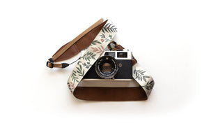 wildtree green and pink Moody Flower Camera Strap botanical flowers print attached to camera