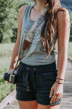 Load image into Gallery viewer, Women holding camera with Wildtree national park camera strap over shoulder