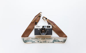 Wildtree Respect our parks words national park camera strap attached to film camera