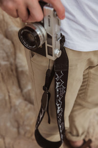 wildtree camera strap man holding camera