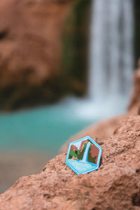 Iron on patch leaned up against red rock wildtree havasupai falls patch design infront of havasu falls arizona