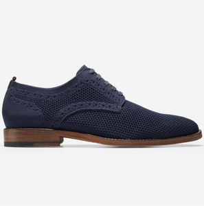 Blue dress shoes with wooden brown sole with fine stitch details