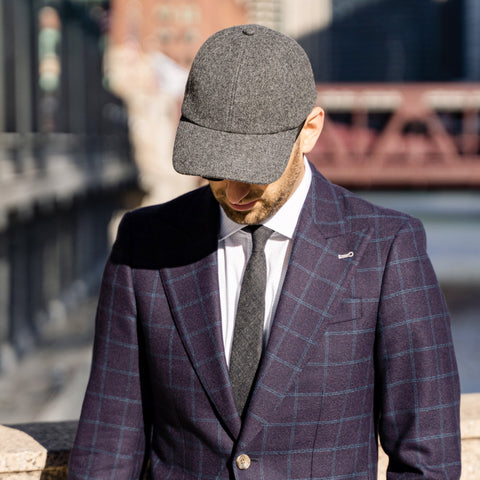Vandre premium charcoal flannel hat styled by Dapper Professional wearing a blazer, tie and chinos.