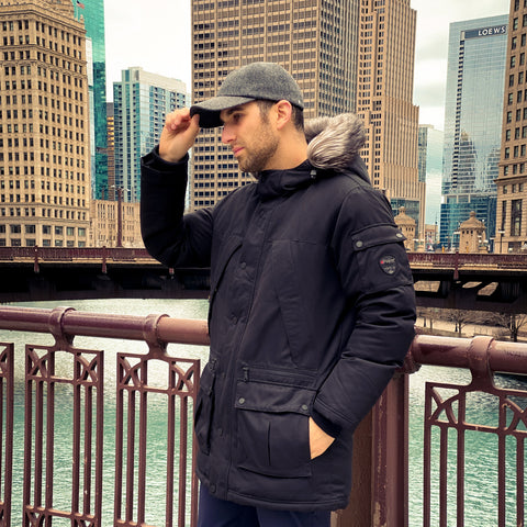 Vandre premium baseball hat styled by Dapper Professional wearing a winter parka in Chicago.
