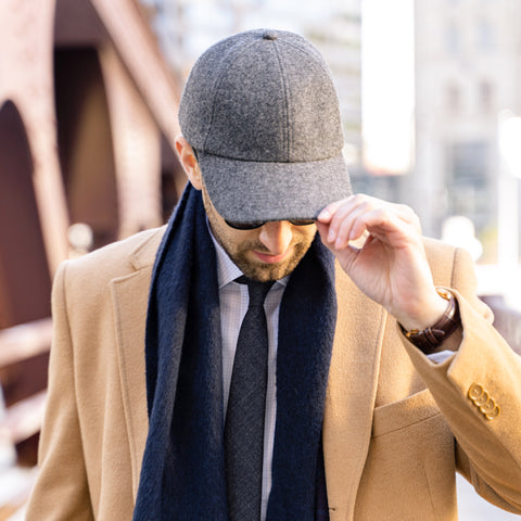 Vandre premium charcoal flannel hat styled by Dapper Professional wearing a blazer, tie, and camel top coat.