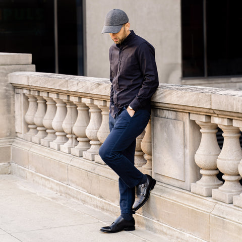Vandre premium charcoal flannel hat styled by Dapper Professional wearing a black button down shirt and chinos with a pair of black double monk strap shoes.