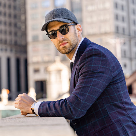 Vandre premium charcoal flannel hat styled by Dapper Professional wearing a suit and tie combination and sunglasses looking at the camera.